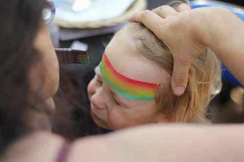 rainbow woman stroking child's hair childhood