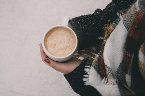 cup person holding white ceramic mug winter