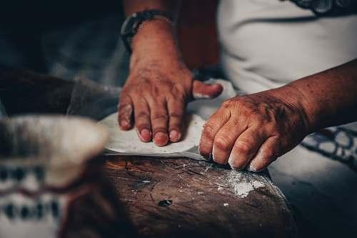 human man making roti person