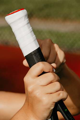 clothing person holding tennis racket apparel