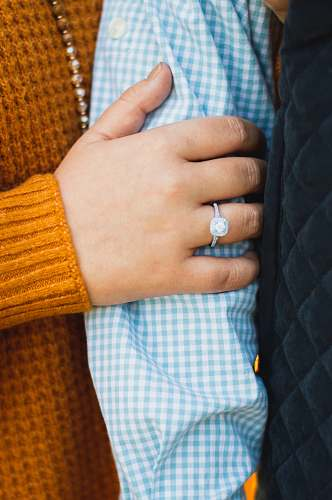 person person in yellow knit sweater with silver ring human