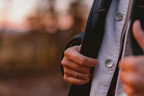 human person touching blazer coat