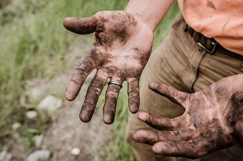 hands A man with his hands covered with mud work