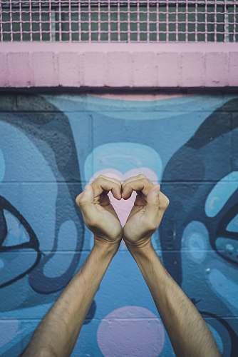 art human hands doing heart gesture painting