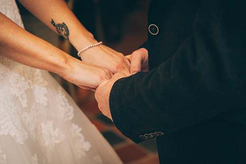 wedding man and woman holding each others hand couple