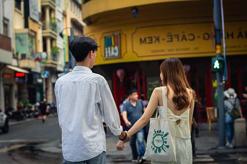 person man and woman standing on street human