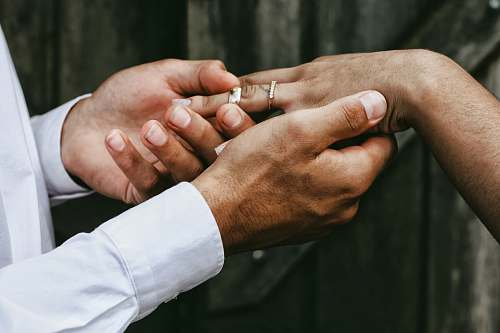people man holding person's hands wedding