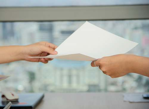 person person handing over paper human