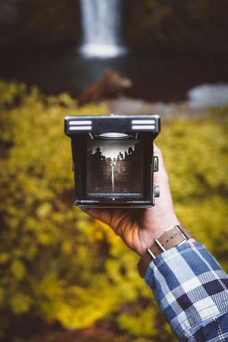 holding person holding black frame multnomah falls