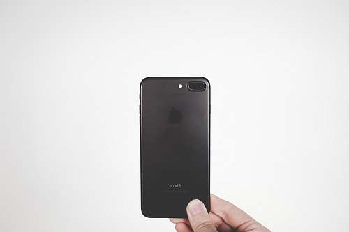 photo grey person holding black iPhone 7 Plus cell phone free for commercial use images