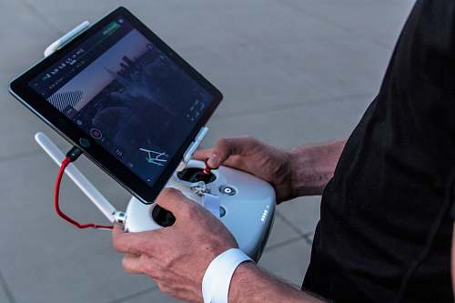 drone person holding quadcopter controller tablet