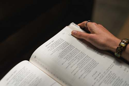 bible person holding white book text