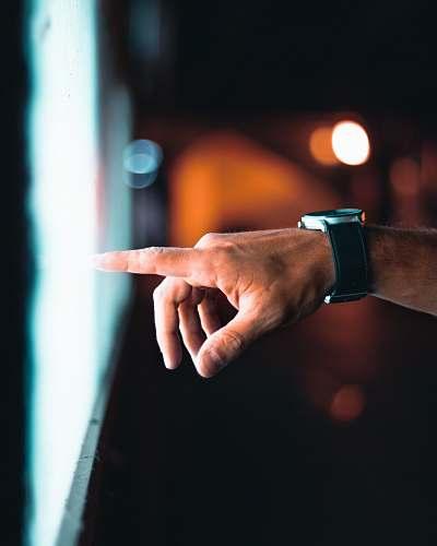 wristwatch person pointing through window finger