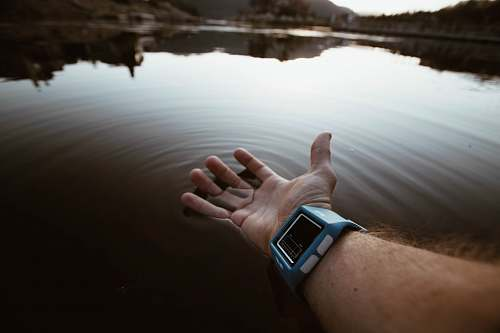 water person touching body of water watch
