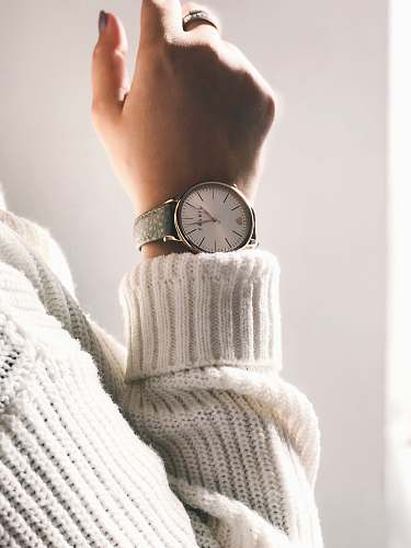 wrist person wearing round silver-colored analog watch watch