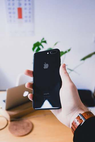 photo holding person's hand holding jet black iPhone 7 Plus mobile phone free for commercial use images
