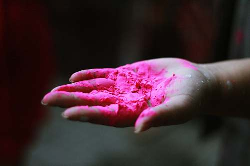 finger pink powder in right human palm pink