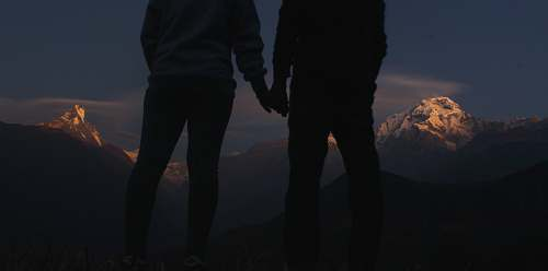 person silhouette photo of two people holding hands holding hands