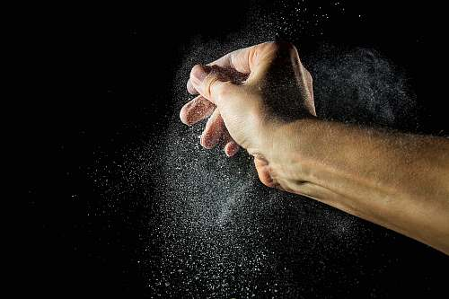 animal time lapse photography of person's hand with powder pet