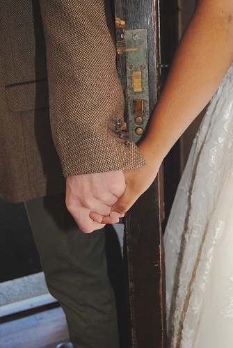 apparel two person holding hands holding hands