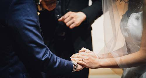 apparel woman holding man's hand during wedding ceremony clothing