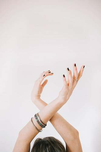 people woman raising her both hands hands