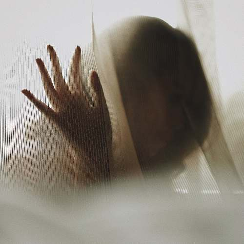woman woman touching white textile texture