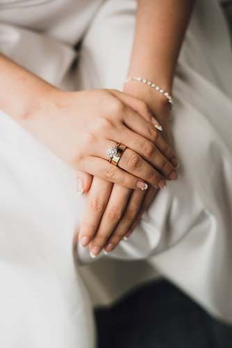 wedding woman wearing gold-colored and silver-colored rings ring