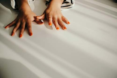 person woman with orange manicure human