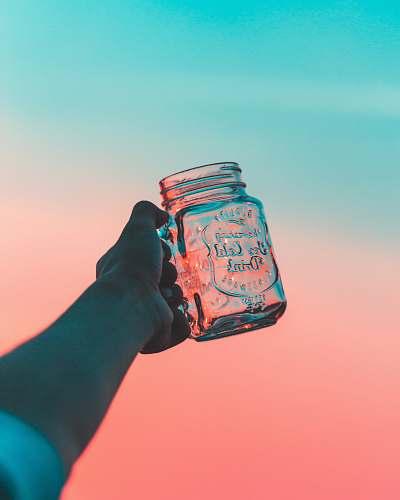 pastel closeup photo of person's holding jar jar