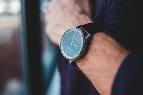 person black analog watch reading 9:03 wristwatch