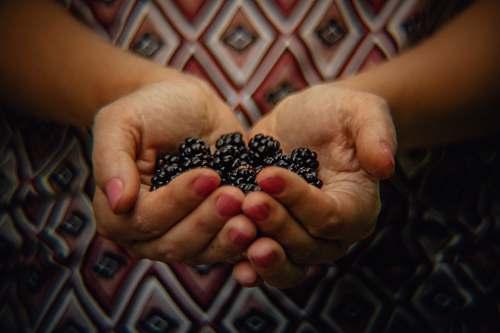 person black berries finger