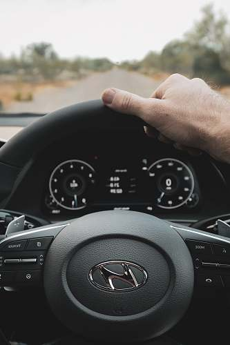 person black Hyundai steering wheel transportation