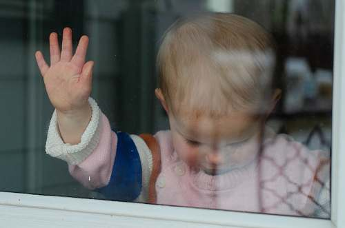 person child behind clear glass finger