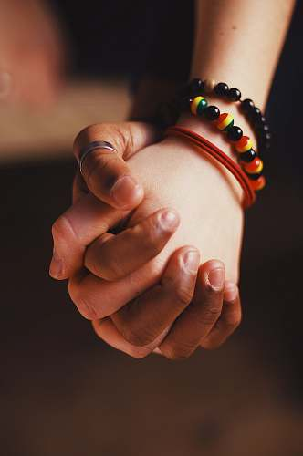 person couple holding hands while wearing ring and bangle hand