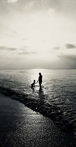 person gray-scale photo of woman and child nature