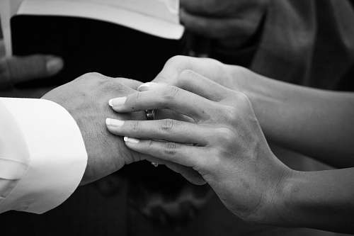 person grayscale photography of woman sucking ring on man finger black-and-white