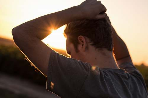 people man holding his hair against sunlight man