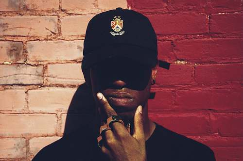 person man with cap and background with red and pink wall l people
