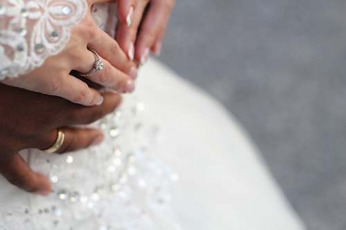 person people holding hands while wearing gold-colored wedding rings wedding
