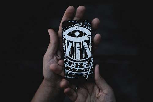 person person holding black and white phone case people
