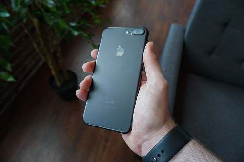photo phone person holding black iPhone 7 Plus iphone free for commercial use images