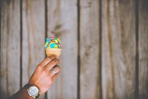 person person holding multicolored ice cream people