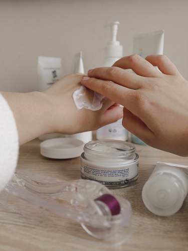 person person using cream on hand hand