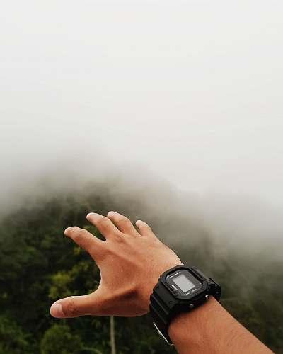 person person wearing black digital watch wristwatch