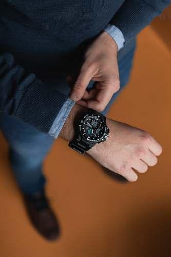 person person wearing round black analog digital watch wristwatch