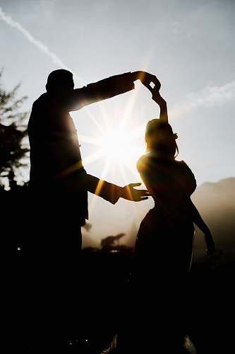 person silhouette of man and woman hand