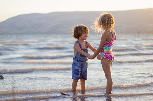 person two girls standing on seashore family