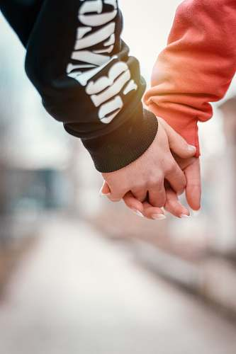 hand two person holding hands in selective focus photography holding hands