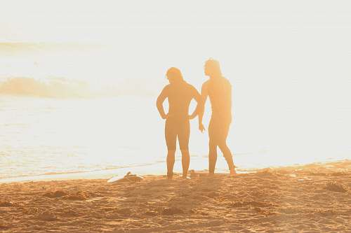person two persons on seashore hand